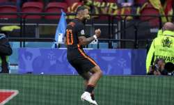Memphis Depay of the Netherlands celebrates after scoring