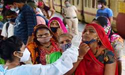 A medic collects nasal sample for Covid test from a