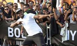Jamaican sprinter Usain Bolt strikes his now-famous victory
