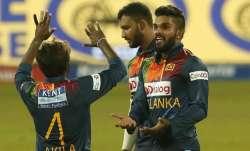 Sri Lanka's Wanindu Hasaranga, right, celebrates taking the