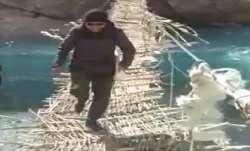 Ladakh, Jamyang Namgyal, Ladakh MP, wooden bridge, raging river, ladakh mp crosses handmade bridge,
