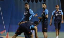Team India mentor MS Dhoni along with skipper Virat Kohli during a practice session ahead of India's
