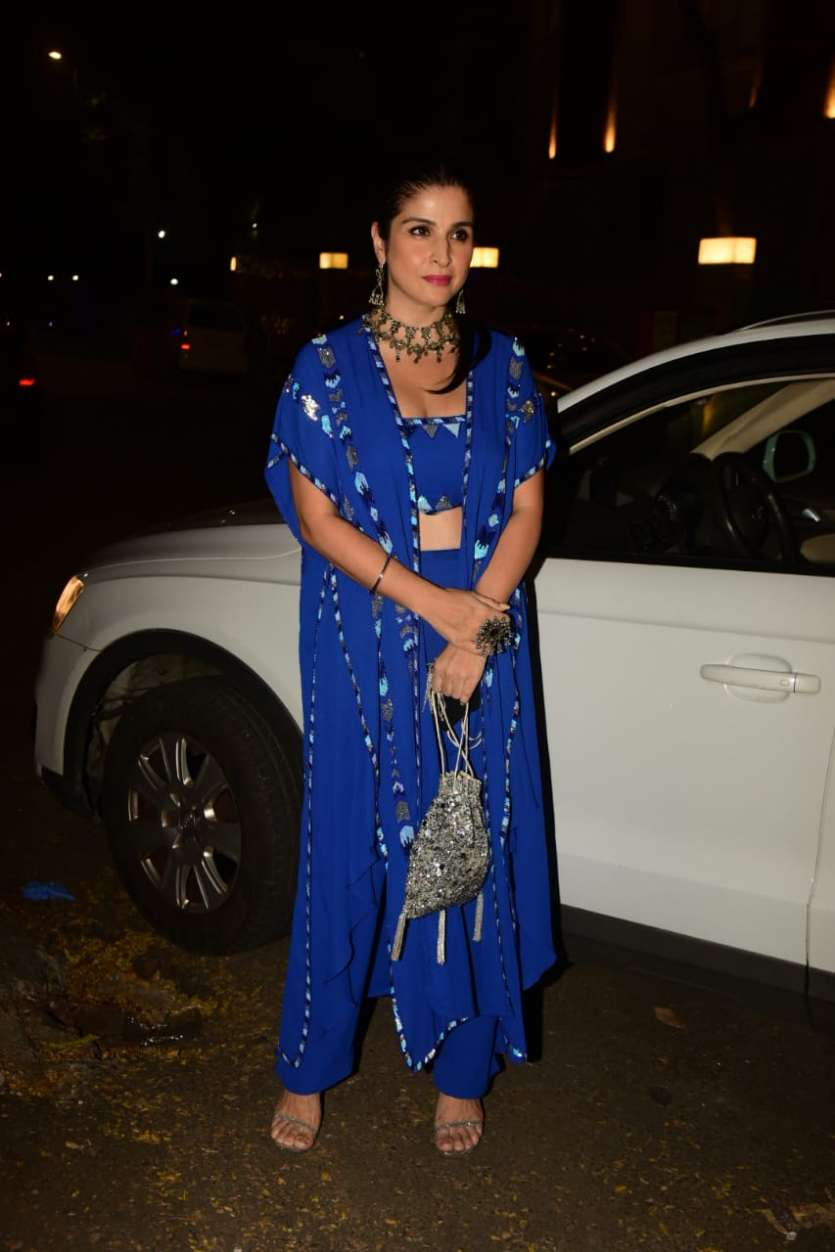 Maheep Kapoor chose a blue coloured indo-western attire and accessorized it with jhumkas and a necklace.