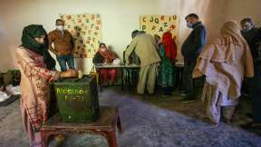 A woman casts her vote for the District Development Council elections, at Purmandal in Samba distric