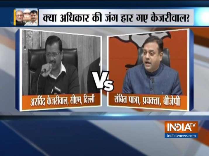 Kejriwal raises questions over SC verdict, BJP slams him